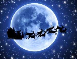 santa-and-reindeer-in-front-of-moon